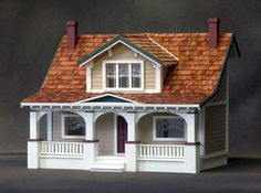 craftsman bungalow miniature dollhouse kit -this looks very much like my house - except it isn't beat up, faded and falling apart.