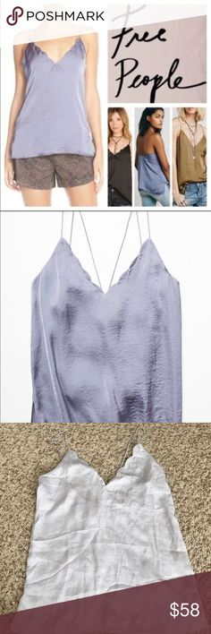 Free People Scallop Edge Cami NWOT Strappy, scalloped V-neck cami in a semi-sheer silky fabric. 100% Polyester. Measurements for Small: Bust: 33 1/4 in = 84 1/2 cm Length: 22 in = 56 cm. Color: moonlight. NWOT new never worn. Size small tag is cut to prevent store return. Rare light Icey blue color which I believe is called moonlight. Very light blue Free People Tops Camisoles