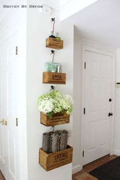 Nesting herb crates hung in kitchen eat-in area hold tabletop necessities (placemats, napkins, salt & pepper)