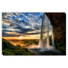 Revoc9's 'Seljalandfoss Waterfall at Sunset' Canvas Gallery Wrap is the perfect way to add character, depth and value to your room. Printed using the highest quality materials to produce a beautiful g