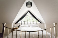 An elegant solution to a tricky triangle window!