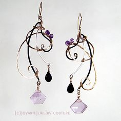Alcina Enigma Earrings with amethyst, spinel, enameled bronze, handforged Sterling Silver and 14k Gold Fill. Hight 3 inch. Width 1 1/4 inch. Also comes in a Necklace!
