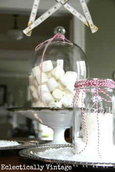 Create an inexpensive centerpiece with a bag of marshmallows and a cloche and bakers twine from HomeGoods! eclecticallyvintage.com #HomeGoodsHappy #HappybyDesign #sponsored