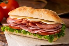 a delicious sandwich with cold cuts lettuce tomato and cheese on fresh ciabatta bread. Quick Recipes, Real Food Recipes, Healthy Recipes, Cooking Recipes, Meat Delivery, Breakfast Bagel, Breakfast Ideas, Tomato And Cheese, Pizza Restaurant