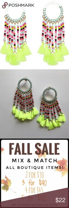 2/$25 Statement Beaded Tassel Earrings Rainbow seed beads and a neon fringe lend a super fun vibe to these boho-inspired beaded tassel earrings. From everyday neutrals to bright hues, these earrings are sure to add a pop to everything in your wardrobe. Measure 3.25 inches long! Jewelry Earrings