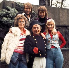 "April 6, 1974: Sweden wins the 19th Eurovision Song Contest held in Brighton, England, represented by the band ABBA and their song ""Waterloo"".  ABBA's win launched the group on its monumental international career, marking the first and still only time that the contest crowned a previously unknown winner destined for legitimate superstardom.    Photo: An actor playing Napoleon (center) poses with the pop group ABBA, (L-R) Anni-Frid Lyngstad, Benny Andersson, Björn Ulvaeus, Agnetha Fältskog,"