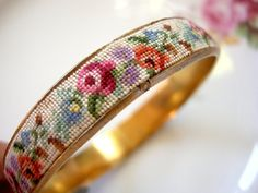 Vintage Needlepoint Bangle Bracelet by modernlovevintage on Etsy.bet this would be easy to do with a cheap plastic bangle Cross Stitching, Cross Stitch Embroidery, Hand Embroidery, Cross Stitch Patterns, Broderie Bargello, Bangle Bracelets, Bangles, String Of Pearls, Diy Schmuck