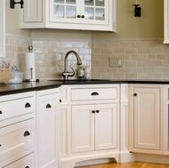 Off-white kitchen cabinets with subway tile
