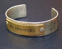 Do the math! Hand hammered, hand stamped aluminum and brass cuff bracelet.