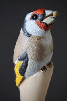 Detail of carved goldfinch walking stick