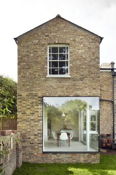 Cousins & Cousins | A two-storey 'chameleon' extension transforms a London townhouse into a contemporary family home