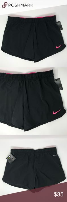 Nike Phantom 2 in 1 shorts Women's Nike Phantom 2 in 1 Training Shorts Dri-FIT fabric technology wicks moisture to help keep you dry and comfortable taffeta with an Everquick finish for quick-drying performance Elastic waist with an internal draw cord for a snug and adjustable fit Swoosh design trademark at the left leg opening Pink Compression Briefs inside  NWT Retail price $40  🚫 No trades 📬 Same or next business day shipping!  ✨ Open to reasonable offers 📦 Bundle to save on shipping…