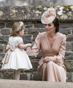 ENGLEFIELD GREEN, ENGLAND - MAY 20: Catherine, Duchess of Cambridge and Princess Charlotte of Cambridge attend the wedding of Pippa Middleton and James Matthews at St Mark's Church on May 20, 2017 in Englefield Green, England. (Photo by UK Press Pool/UK Press via Getty Images) via @AOL_Lifestyle Read more: https://www.aol.com/article/entertainment/2017/05/20/kate-middleton-serves-as-unofficial-bridesmaid-at-pippa-middleto/22100726/?a_dgi=aolshare_pinterest#fullscreen