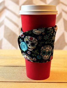 A personal favorite from my Etsy shop https://www.etsy.com/listing/258554322/sugar-skull-beverage-cozy-sleeve-with