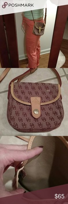 Dooney & Bourke crossbody 😘sale.  Just love this little bag. Still unsure of selling it, it's so cute. Only blemish is light spot you can see on front. 100% authentic. Leather straps, red and brown trade mark. Snap closure and has a outside pocket. Shoulder drop is 23 inches , purse is 6 inches wide and  6 inches deep. Just adorable Dooney & Bourke Bags Crossbody Bags