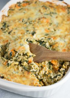 Sweet Potato Brown Rice Casserole recipe made with mushrooms, spinach, mozzarella, parmesan, and cheddar. A hearty vegetarian comfort food recipe.