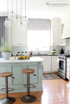 DIY -  Kitchen Makeover - Transform your builder's grade kitchen with paint and clever diy.