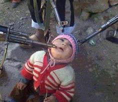 """Baby  captive in Syria taken in a predominantly Christian Armenian village near the Syrian border with Turkey, has not yet been verified with some online critics suggesting it is a propaganda stunt by the government to whip up support for the Assad regime. (please note these rebels are doing awful and evil things, so do not buy that """"good rebels"""" crap the media is trying to feed you."""