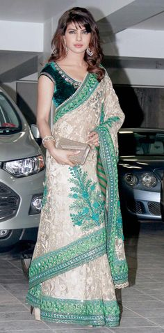 Priyanka Chopra looks stunning in beige-green sari with her hair let down at Aamir Khan's Diwali bash. #Bollywood #Fashion #Style #Beauty #Page3