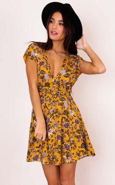 This gorgeous floral printed dress is so sweet. It features little button details at the front, a plunging neckline and cinched waist to highlight your figure! Pair up with some sandals or sneakers for a more casual look.