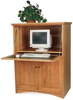here is a much more traditional home office option this small computer armoire allows you