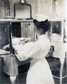 Nurse with an infant in the Baby Incubator exhibit on the Pike at the 1904 World's Fair. | collections.mohistory.org