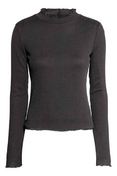 Rib-knit jumper: Jumper in a soft rib knit with a turtle neck, overlocked frilled edges and long sleeves.