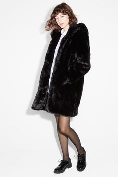 A legendary black faux fur coat with a fur hood - the stuff of Siberian dreams!