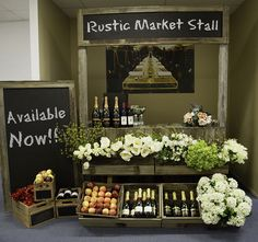 Rustic market stalls - super cute! Betting this could be done with pallet wood. Love use of varying heights.