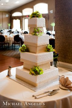 Modern Tower & Orchids #2Modern  This cake definitely has the height if you are looking to impress your guests! This seven-tier square cake is made with inserts with each layer covered in fondant. Fresh orchids were added on by the florist.