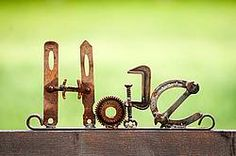 Hand crafted hope garden art sign made out of recycled or repurposed farm tools and machinery parts then welded together