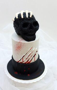Skull cake and skeleton hand.