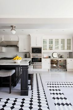 Beautiful kitchen design with white subway tile for the walls and backsplash, couple with a geometric design for the floor.