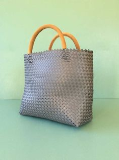 plastic strap bag with leather handles