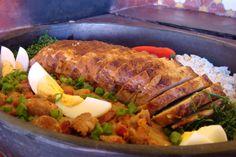 Faire frire le lard (et réserver). Dans la graisse du lard, faire revenir l'oignon et l'ail, puis ajouter les haricots noirs. Bien mélanger et assaisonner.