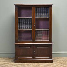 OnlineGalleries.com - Small Antique Edwardian Walnut Glazed Bookcase on Cupboard