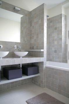 Bathroom tiled with handmade zelliges