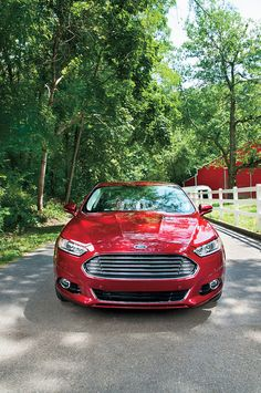 Ford Fusion. For some reason I am really drawn to this car I love the look of it. The red color is cute also.