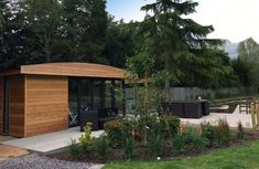 garden room design showcasing a unique curved roof. The turns the space into an hub.