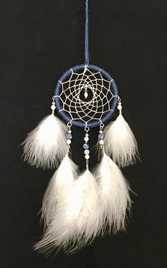 A personal favorite from my Etsy shop https://www.etsy.com/listing/587604713/blue-dream-catcher-dream-catcher-for-car