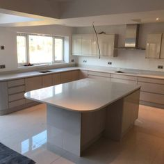 We fitted this Bianco Marmo Suprema quartz worktop for our customer this week. This colour is able to transform an existing or new kitchen and make it ultra classy. New Kitchen, Kitchen Ideas, Kitchen Island, Marble Effect, White Quartz, Open Plan, Supreme, Table, Furniture