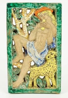 """Jolan Cser (Hungarian, Early 20th Century) A Plaque. Glazed earthenware plaque depicts a nude male playing the lute, with a ram by his side. Green rectangular border. Verso is signed and dated """"Cser J 1940"""" 8.5"""" x 5"""""""