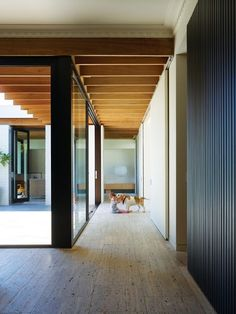 This hallway is full of lines. The horizontal lines on the floor combined with the horzontal lines on the room add a sense of harmony  and help the space to flow together while the vertical lines on the wall add height to the hall.
