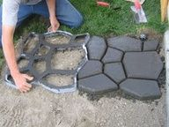 Walk path Mold at Lowes for 16 bucks, bag of quikcrete is 5 bucks.  Add any color and DIY...  done son!!      QUIKRETE Country Stone Walk Maker Concrete Mold  Item #: 10415