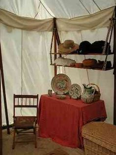 Shelves can be made of simple boards strung between two poles. Rope or upholstery webbing can be used as slings, and loop over the tent poles with grommets if needed. These shelves are very sturdy, and can actually be placed one above the other if necessary.