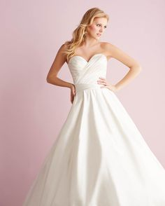 Allure Romance, 2713: This satin ballgown is incredibly rich in texture and features a ruched bodice with a strapless, sweetheart neckline. This simple, chic gown is perfect for accessorizing.