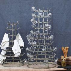 antique wine bottle drying rack, now used for glasses & napkins