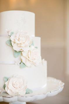 white wedding cake with sugar flowers -