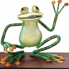 Frog Whimsical Metal Tabletop Decor Waving - Regal Art #A593 by Regal Art and Gift. $21.97. Mix And Match Items In Same Or Different Themes.. Extensive Handcrafting Is Put Into Each Piece.. Use Of Richly Colored Automobile Paint Creates Quality, Durable Finish.. Special Painting Techniques Creates A 'Patina' Effect.. This Frog Whimsical Metal Tabletop Decor Waving - Regal Art #A593 is a perfect little collectible critter for yourself or as a gift. Hand-forged from quality met...