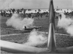 Japanese plane being straffed just after it landed.